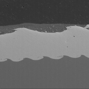 Explosively bonded aluminum-steel material.  (Sample courtesy of High Energy Metals, Sequim, WA)